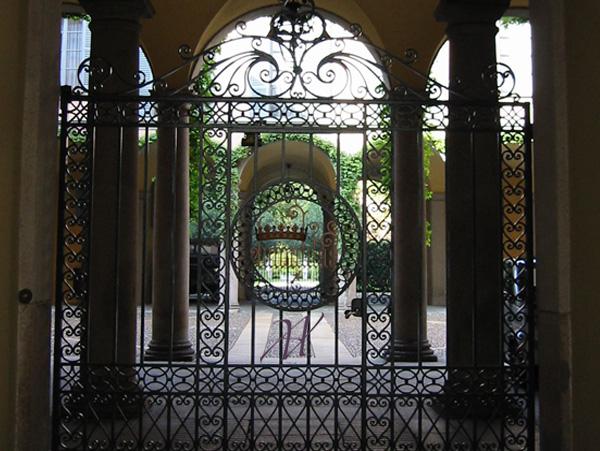 silent corner beyond wrought iron gate