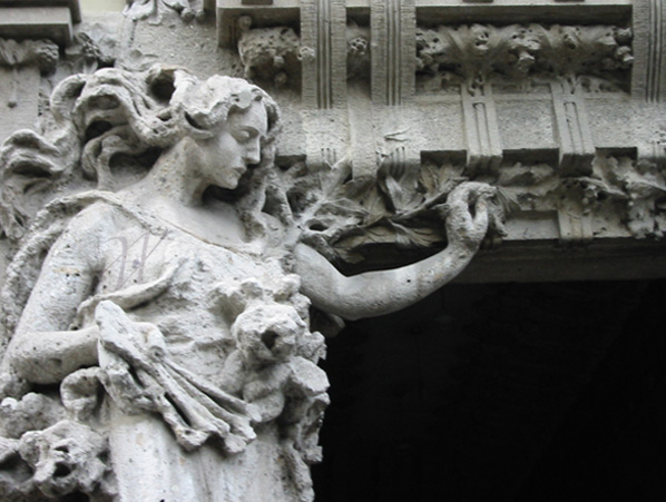 Art Nouveau figure on a city gate